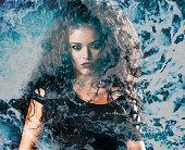 Double exposure of rocker woman and sea foam texture