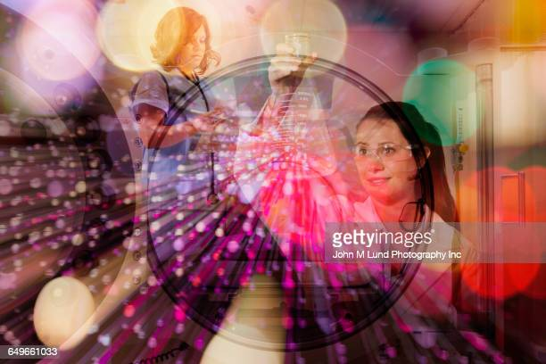 Double exposure of scientists and nurse over city lights