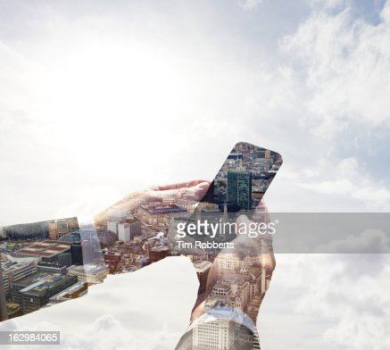 Double exposure of smart phone and London. : Stock Photo