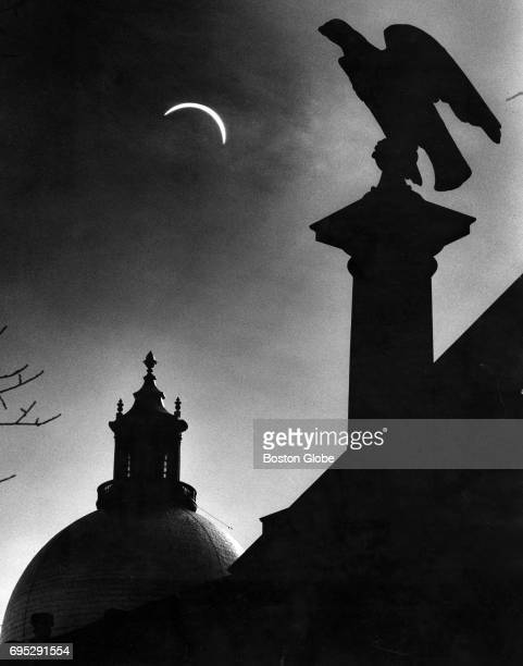 A double exposure of the eclipse at 146 pm behind the State House March 7 1970 in Boston A long lens brings the sun closer while a wider lens shows...