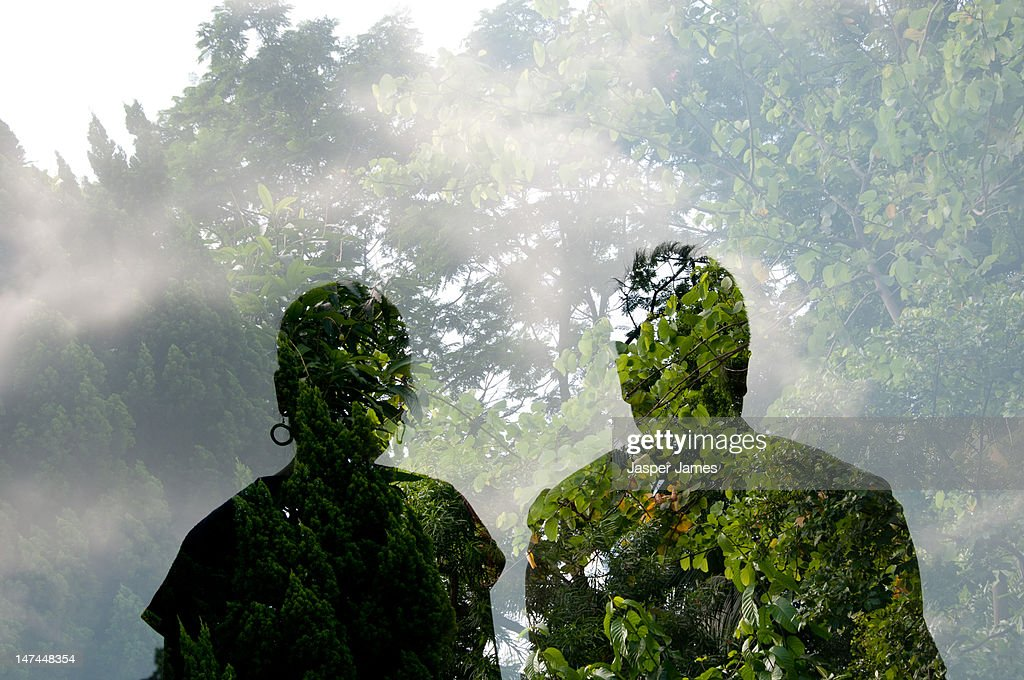 double exposure of two people and trees : Stock Photo
