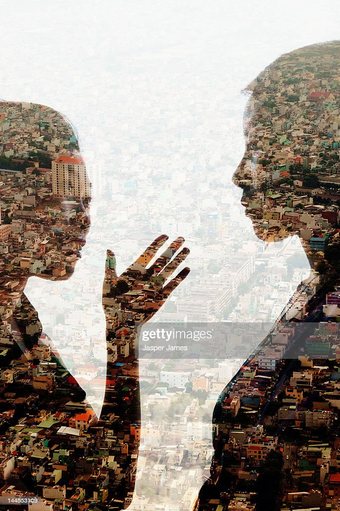 double exposure of two women talking and cityscape : Stock Photo
