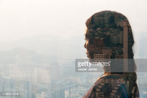 double exposure of woman and cityscape : Stock Photo