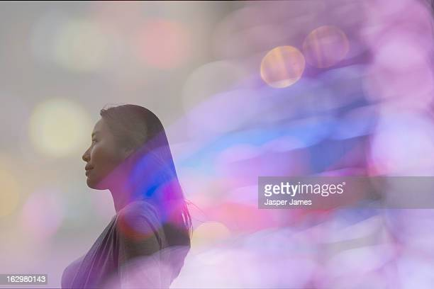 double exposure of woman and lights