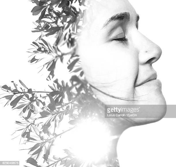 Double Exposure Of Woman And Plants Against White Background