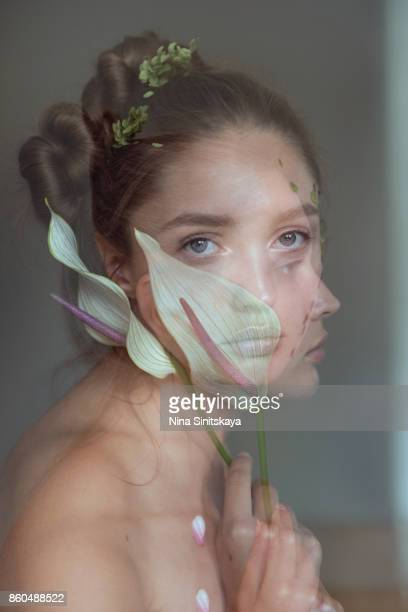 Double exposure of woman face with white flower