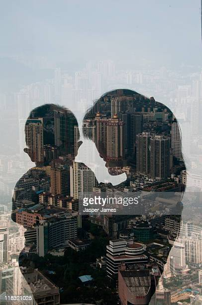 double exposure of woman holding baby and cityscap