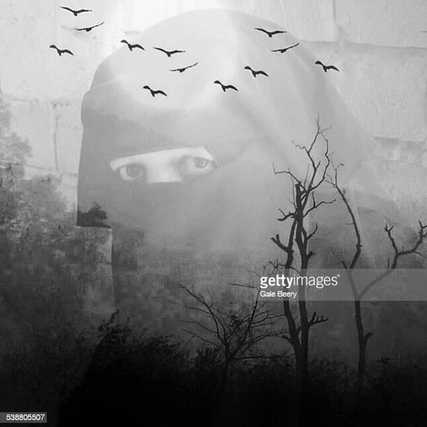 Double exposure of Woman in black with Birds overhead