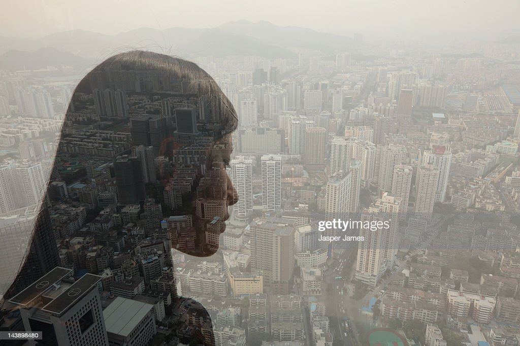double exposure of woman looking at cityscape : Stock Photo