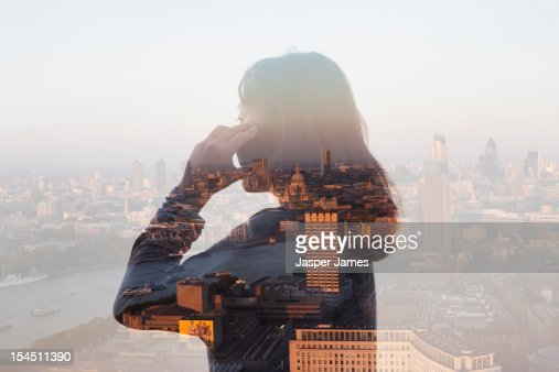 double exposure of woman using phone and cityscape : Stockfoto