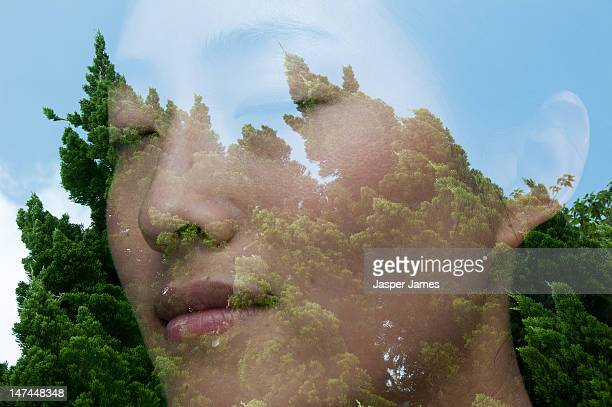double exposure of womans face and trees