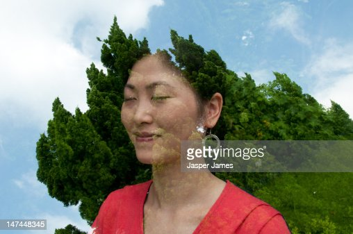 double exposure of womans head and trees : Stock Photo