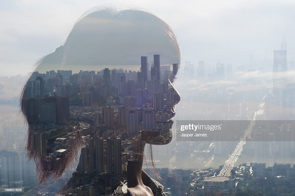 double exposure of young woman and cityscape : Stock Photo