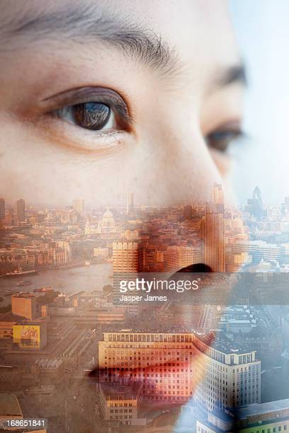 double exposure of young womans face and cityscape