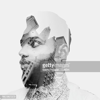 Double Exposure On Man Face Against White Background