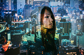 Double exposure photo of woman and a city.