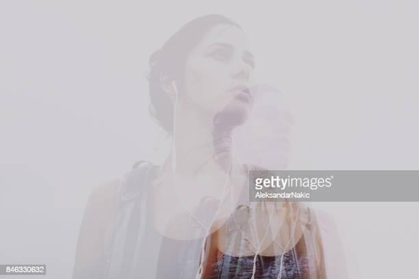Double exposure portrait of a female hiker