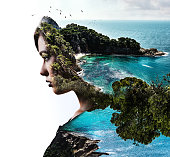 Double exposure. Portrait of a woman combined with a rocky coast and sea.
