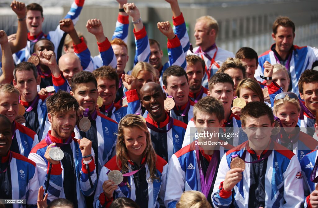 Double gold medalist <a gi-track='captionPersonalityLinkClicked' href=/galleries/search?phrase=Mo+Farah&family=editorial&specificpeople=4819130 ng-click='$event.stopPropagation()'>Mo Farah</a> of Great Britain (C) poses with other medalists during a TEAM GB Press Conference during Day16 of the London 2012 Olympic Games at Team GB house on August 12, 2012 in London, England.