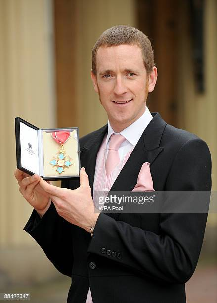 Double gold medallist cyclist Bradley Wiggins outside Buckingham Palace after being awarded an CBE by the Prince of Walesduring the investiture...