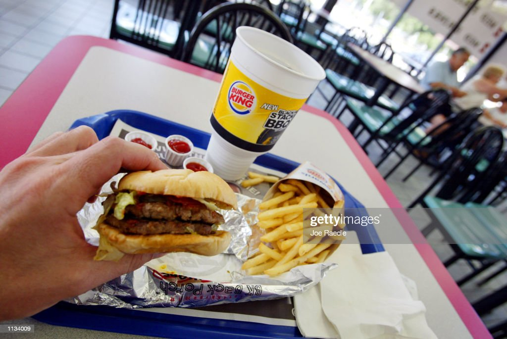 A double hamburger with a King Fries and a King size Coke is seen on July 18, 2002 at a Burger King in Miami, Florida. The health effects of an American diet of super-sized fast foods are becoming apparent as increasing numbers of children and adults are being treated for obesity. Studies seem to point to the fact that many overweight children and adults get a large portion of their calories by consuming too many sodas and sweetened juices and beverages. Sweetened drinks + 'super-sized' meals + the convenience of fast food + a decrease in physical activity = a recipe for obesity.