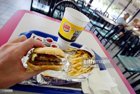A double hamburger with a King Fries and a King size Coke is seen on July 18 2002 at a Burger King in Miami Florida The health effects of an American...