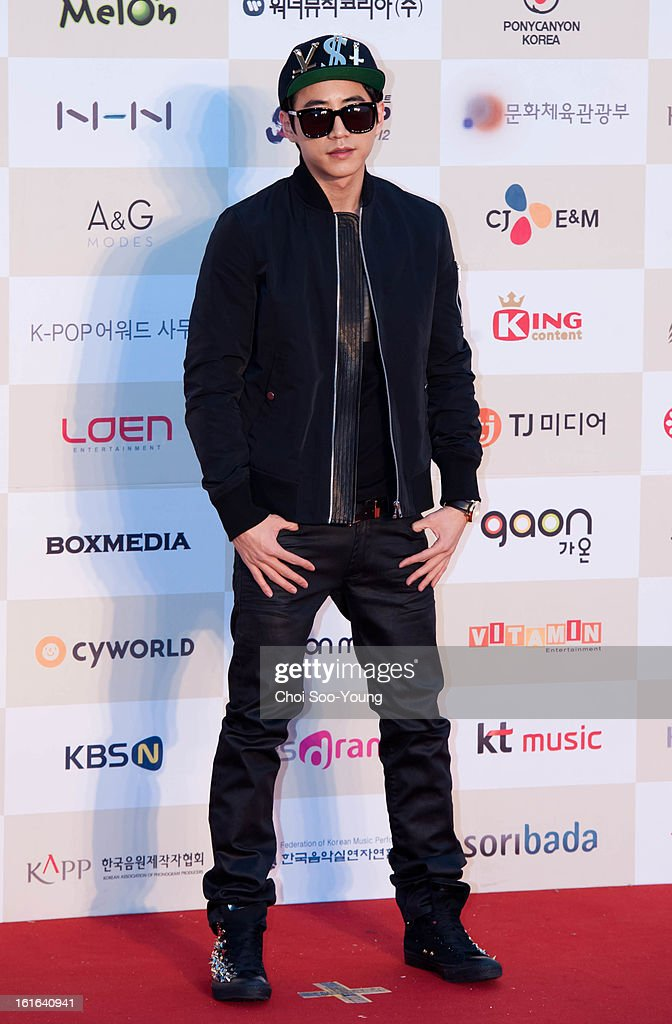 Double K poses for photographs upon arrival during '2nd Gaonchart K-pop Awards' at Olympic Hall on February 13, 2013 in Seoul, South Korea.