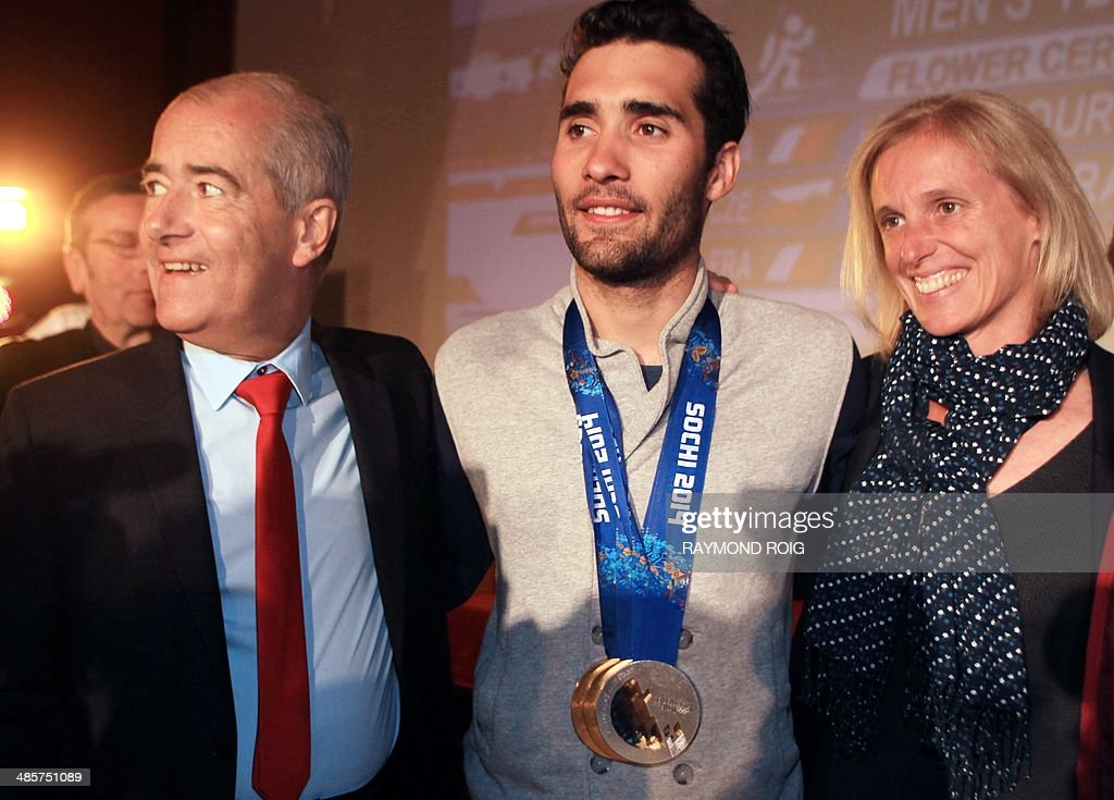 Double Olympic champion biathlete Martin Fourcade (C) poses wearing his medals with the president of the Languedoc-Roussillon <a gi-track='captionPersonalityLinkClicked' href=/galleries/search?phrase=Christian+Bourquin&family=editorial&specificpeople=862462 ng-click='$event.stopPropagation()'>Christian Bourquin</a> (L) and Junior minister to handicapped people Segolene Neuville (R) during a meeting with his fans in Font-Romeu, in the French Pyrenees, southern France, on April 20, 2014. Fourcade, 25, was cheered by 600 people during a visit in the ski resort where he obtained his first results.