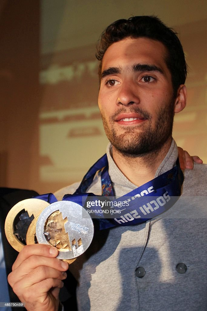Double Olympic champion biathlete Martin Fourcade poses with his medals during a meeting with his fans in Font-Romeu, in the French Pyrenees, southern France, on April 20, 2014. Fourcade, 25, was cheered by 600 people during a visit in the ski resort where he obtained his first results.