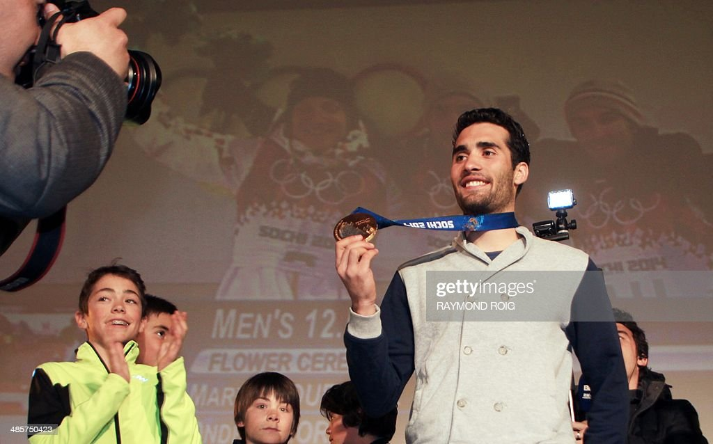 Double Olympic champion biathlete Martin Fourcade poses with his medal in Font-Romeu, in the French Pyrenees, southern France, on April 20, 2014. Fourcade, 25, was cheered by 600 people during a visit in the ski resort where he obtained his first results.