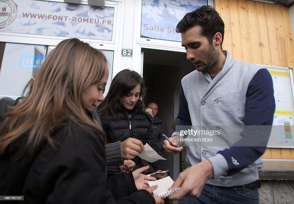 Double Olympic champion biathlete Martin Fourcade signs autographs to young fans after a press conference in Font-Romeu, in the French Pyrenees, southern France, on April 20, 2014. Fourcade, 25, was cheered by 600 people during a visit in the ski resort where he obtained his first results.