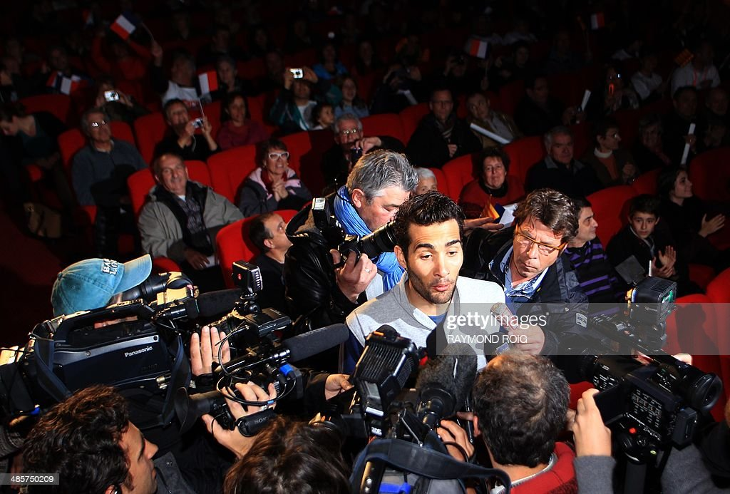 Double Olympic champion biathlete Martin Fourcade speaks to journalists in Font-Romeu, in the French Pyrenees, southern France, on April 20, 2014. Fourcade, 25, was cheered by 600 people during a visit in the ski resort where he obtained his first results.