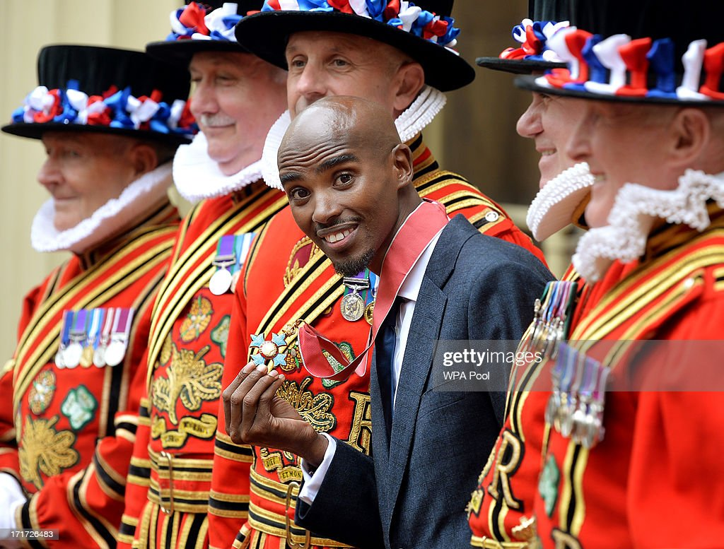 Double Olympic Gold Medal winning athlete Mo Farrah holds his CBE after he received the award from Prince Charles, Prince of Wales during an Investiture ceremony at Buckingham Palace on June 28, 2013 in London, England. Mo Farah will receive an CBE for services to Athletics.