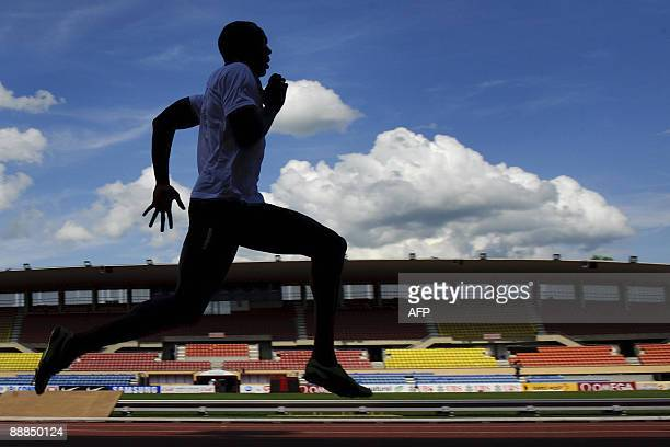 Double Olympic gold medalist Usain Bolt is seen in silhouette during a practice session on the eve of the Super Grand Prix althetics meeting of...