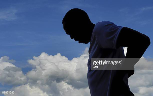 Double Olympic gold medalist Usain Bolt of Jamaica is seen in silhouette during a practice session on July 6 2009 on the eve of the Super Grand Prix...