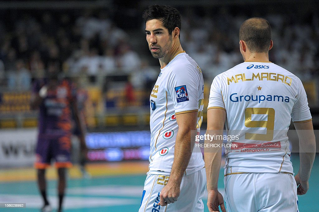 Double Olympic handball champion Nikola Karabatic (L) reacts during his first match with the Montpellier's team against Selestat for the first time after being implicated in the a high-profile match-fixing scandal, on November 11, 2012 in Strasbourg,eastern France. Karabatic, along with 10 other people including his brother Luka, is being investigated by police on suspicion of fraud relating to unusual betting patterns on a match involving his club Montpellier and Cesson-Sevigne on May 2012. AFP PHOTO/FREDERICK FLORIN