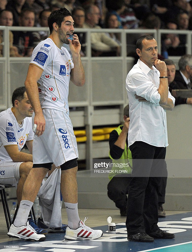 Double Olympic handball champion Nikola Karabatic (L) stands next to Montpellier's coach Patrice Canayer during his first match with the Montpellier's team against Selestat for the first time after being implicated in the a high-profile match-fixing scandal, on November 11, 2012 in Strasbourg,eastern France. Karabatic, along with 10 other people including his brother Luka, is being investigated by police on suspicion of fraud relating to unusual betting patterns on a match involving his club Montpellier and Cesson-Sevigne on May 2012.