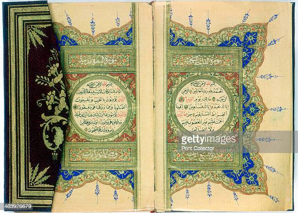 Double page spread from a Koran with marginal floral decoration Turkish 1882