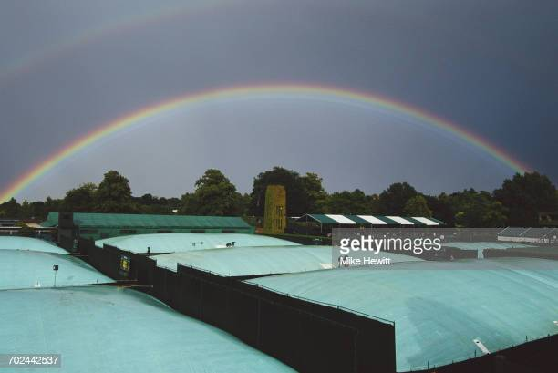A double rainbow appears over the covered courts as rain delays play at the Wimbledon Lawn Tennis Championship on 27 June 1998 at the All England...