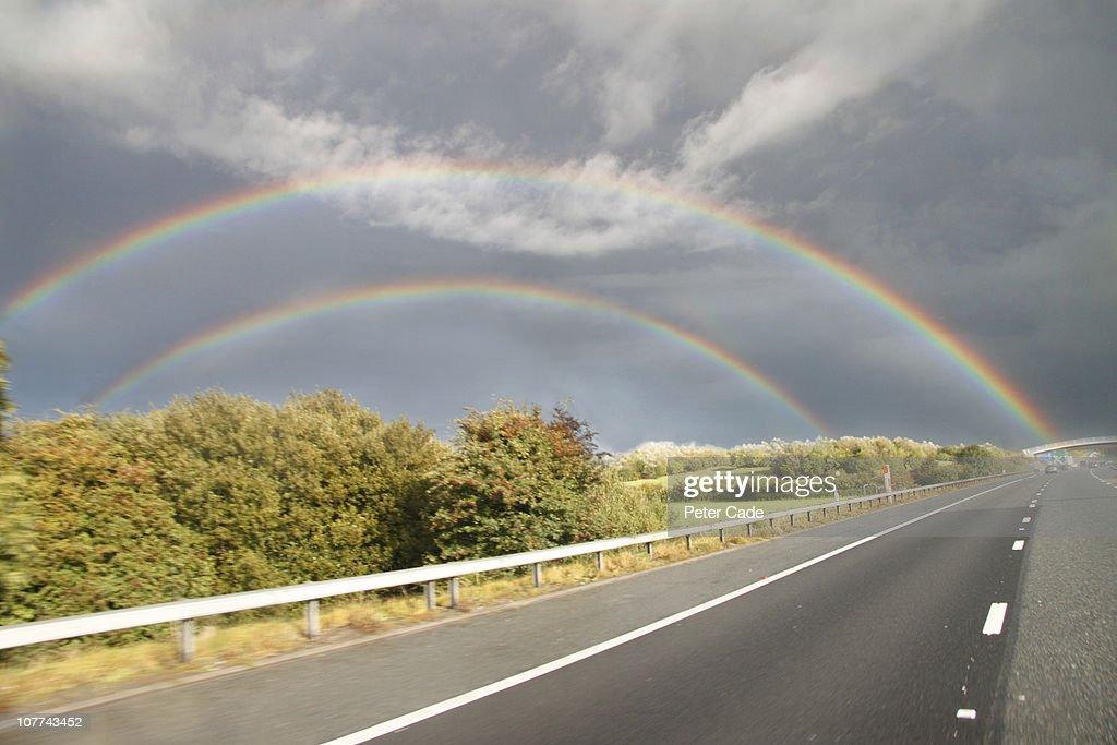 double rainbow next to road : Stock Photo