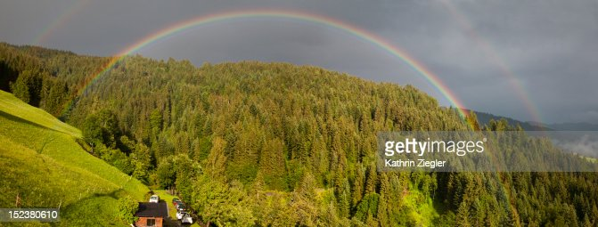 double rainbow over Alpine scenery, panoramic shot : Stock Photo