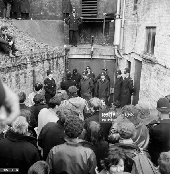 A double rank of policemen guards an entrance to a bunkertype building in Berkshire where nuclear disarmament demonstrators attempted to stage a...