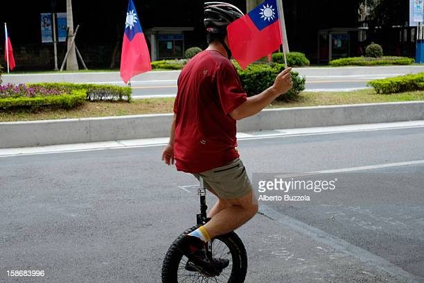 Double Ten Celebration in front of Taiwan Presidential Palace commemorating the 101 birthday of the Republic of China or ROC A man on a monowheel...