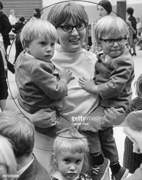 Double the work but three times the fun mothers of twins say Mrs Judd Kramer has two armloads with from left Brian and Brett her 3½yearold sons...