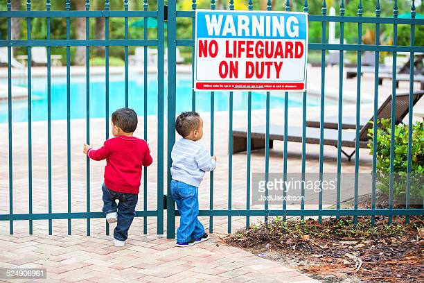 Double trouble. Twin boys try to get into locked pool