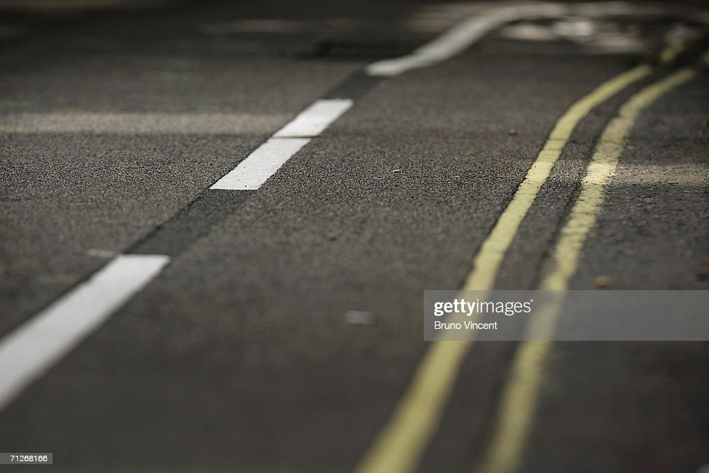 Double yellow lines line the road on June 22 2006 in London England The Commons transport committee report branded the state of Parking enforcement...