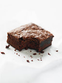 Double-chocolate brownie missing one bite, elevated view