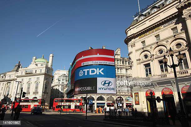 Doubledecker buses travel through Piccadilly Circus on March 19 2012 in London England London's West End is synonymous with theatre productions...