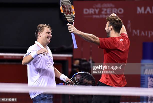 Doubles pair Marcel Granollers of Spain Marcin Matkowski of Poland celebrate their victory following their men's doubles final match against a pair...