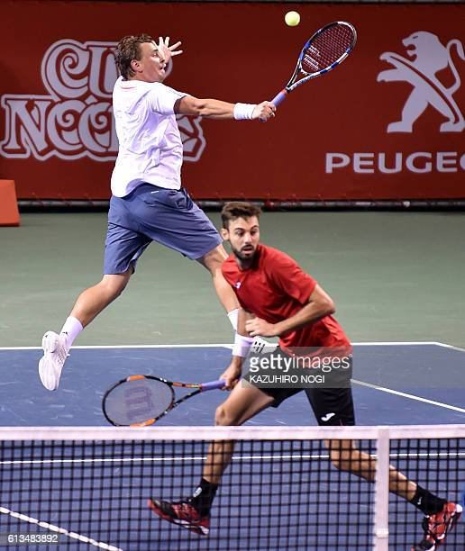 Doubles pair Marcin Matkowski of Poland Marcel Granollers of Spain play during their men's doubles final match against a pair of Raven Klaasen of...